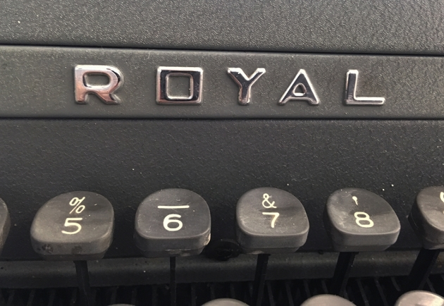 """Royal """"Quiet De Luxe"""" badge, on the front."""