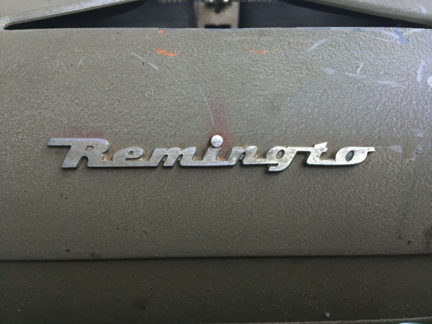 "Remington ""All New"" partial logo..."