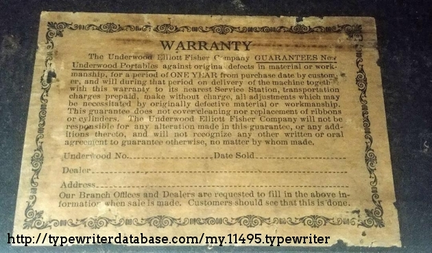 Warranty label inside top carrying case cover