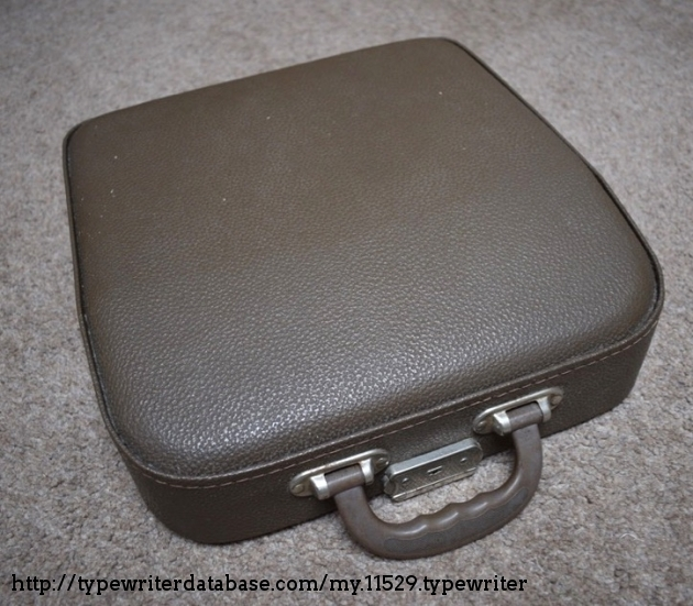 Semi-rigid case, made up of the base which stays connected to the typewriter and the top cover.  The machine is made to be used with the base fitted, as although it's fairly easy to remove the base, there are no feet on the typewriter and the metal edges are quite sharp and the mechanics of the machine extend right to the base.
