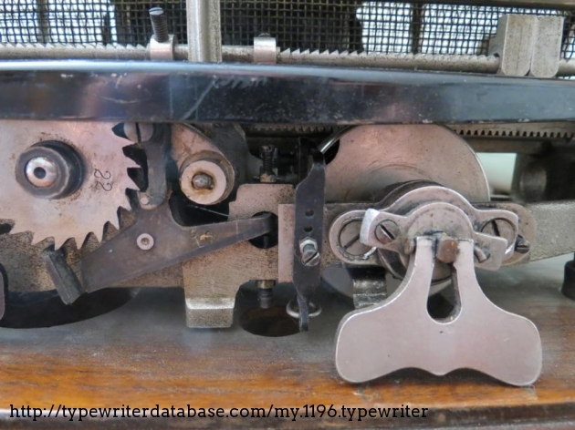View from behind: the escapement spring and gears