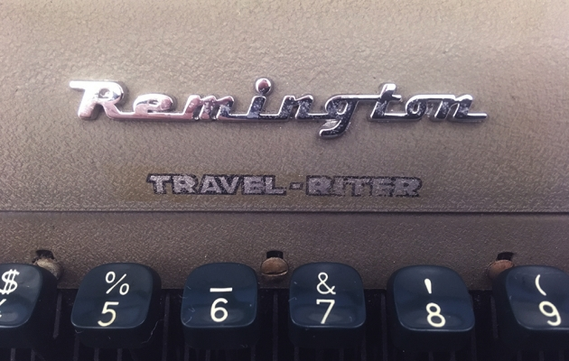 "Remington ""Travel-Riter"" from the front... (logo detail)."