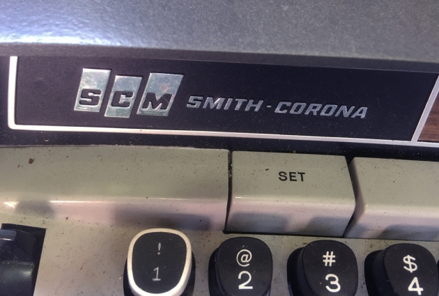 "Smith-Corona ""Electra 220"" front logo (left side)..."