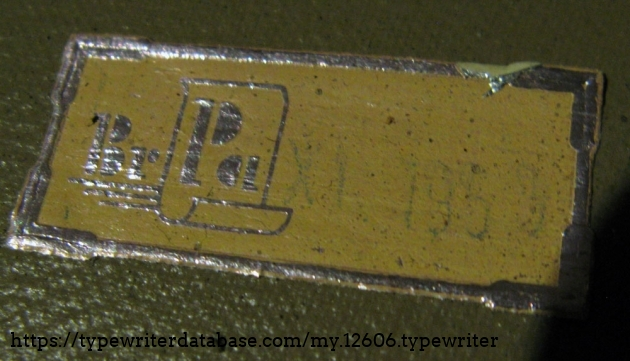 """label in bottom of case, with stamped date: """"X1 1959"""""""