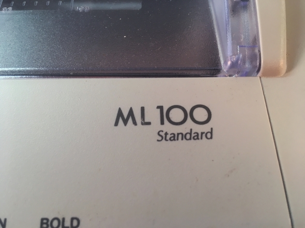 "Brother ""ML 100"" model logo on the front (right)..."