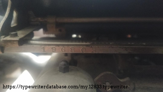 Serial number 196803 on carriage bar