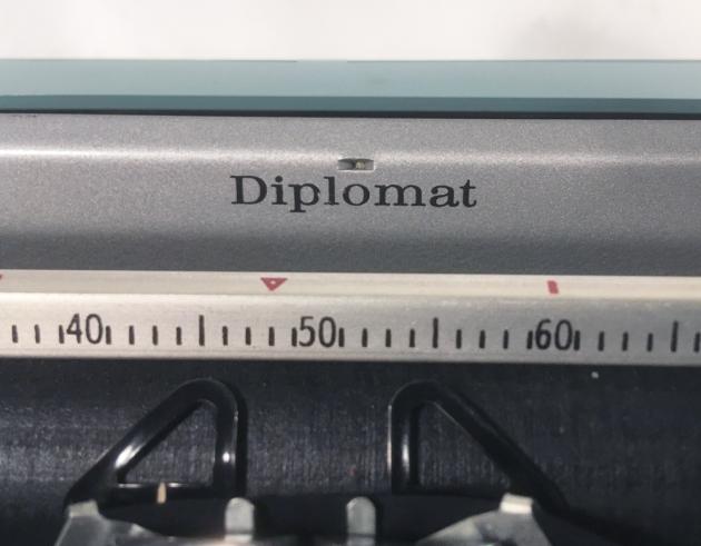"Smith Corona ""Golden Shield Diplomat"" model name at the top..."