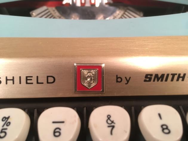 "Smith Corona ""Golden Shield Diplomat"" logo/badge close-up..."