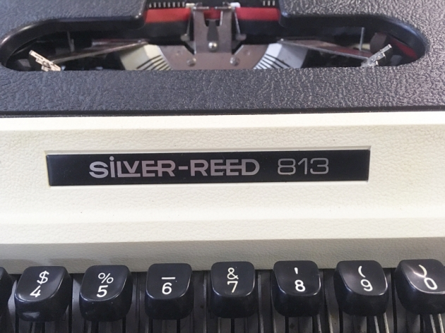 "Silver Reed ""813"" logo from the front..."