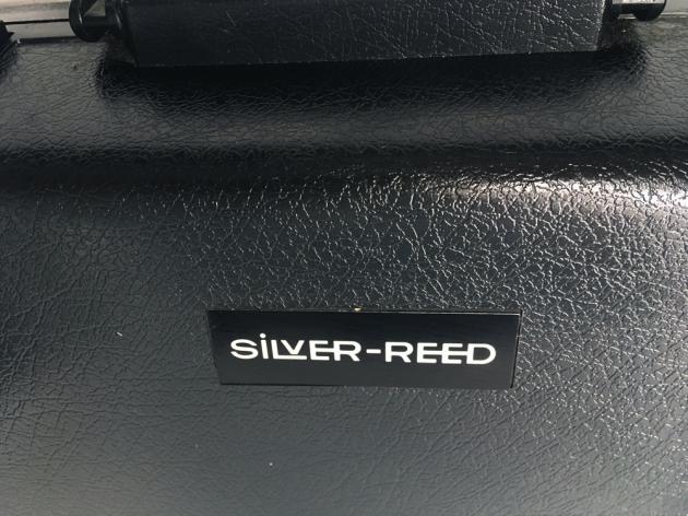 "Silver Reed ""813""  travel case (logo  detail)..."