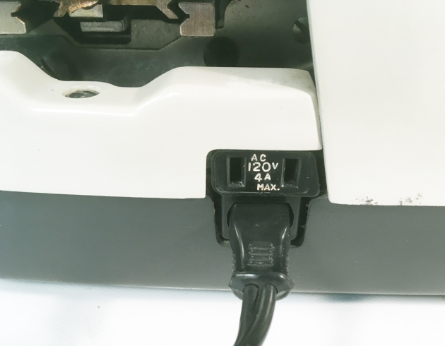 "Remington ""700 Electric"" from the left side (detail of extra outlet, above power cord..."