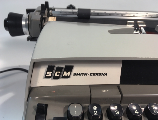 "Smith Corona ""Secretarial 250""brand logo on the right side..."