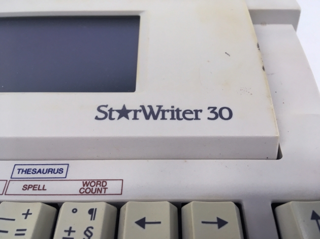 "Canon ""StarWriter 30"" from the logo on the right side..."