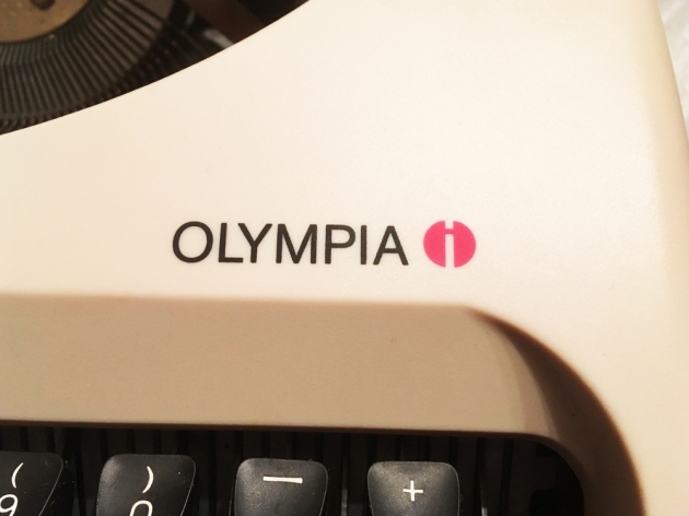 """199X Olympia """"Traveller C"""" logo on the right side..."""