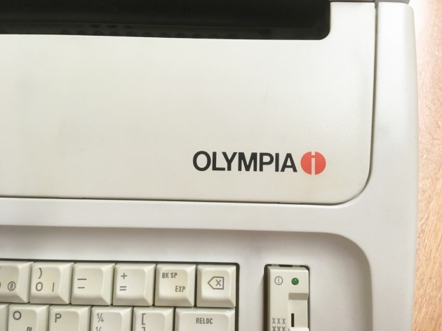 "Olympia ""Carrera"" logo on the top (right)..."