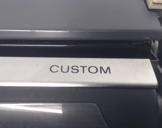 "Royal ""Custom"" logo on the right side..."