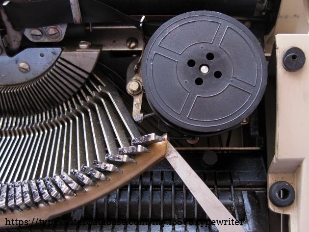 Inside (spool + ribbon reverse mechanism + typebars)