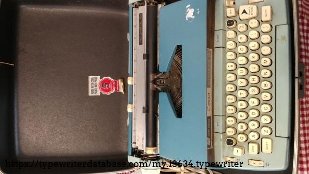 Typewriter in original carrying case.