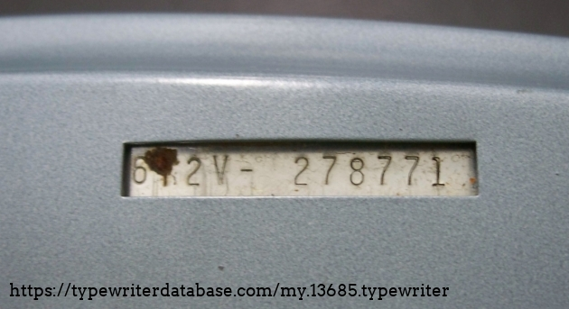 Serial number in cut-out on bottom of machine.  TBH I had forgotten I owned this machine so I haven't taken pictures. :)