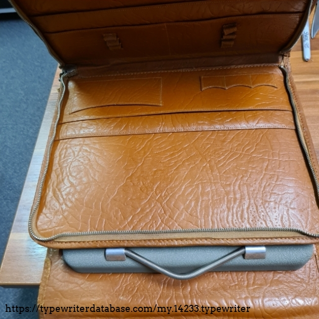 Metal travel case tucks nicely inside the branded leather satchel... very posh!