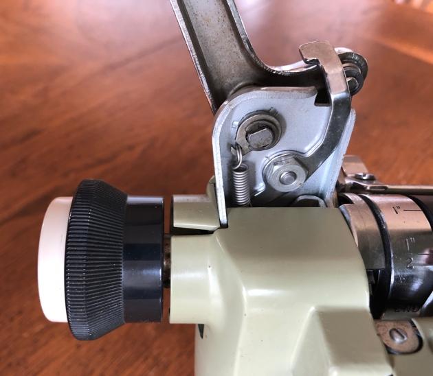 the carriage return lever attachment arrangement