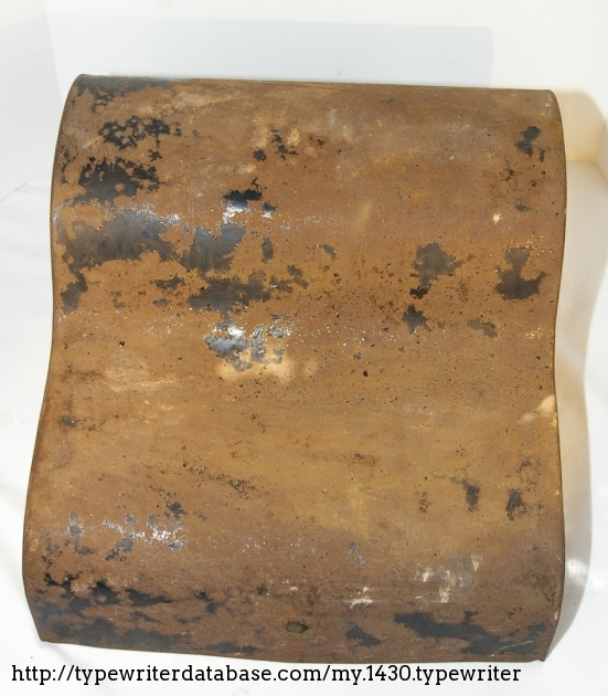 The cover of the carrying case with almost all of the original graphic rusted off.
