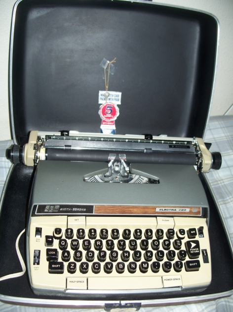 Typewriter in its case, ready for action.