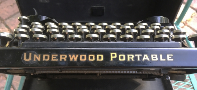 "Underwood ""Portable"" (4 Bank) maker and model logo on the front..."