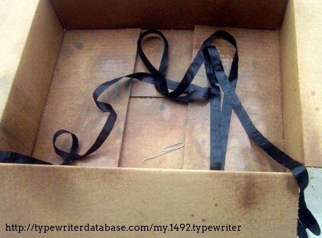 Original ribbon is very short, no more than a couple feet.