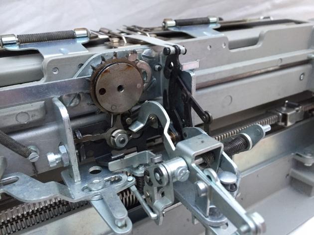 Escapement mechanism. The black metal pieces are part of the ribbon vibrator mechanism.