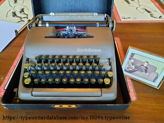 """Dad's """"new"""" typewriter next to a photo of him the year it was made."""