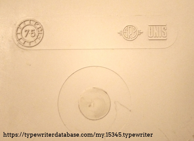 Marks on the inside of the machine cover. We see the logo of the UNIS factory in Sarajevo, Yugoslavia.
