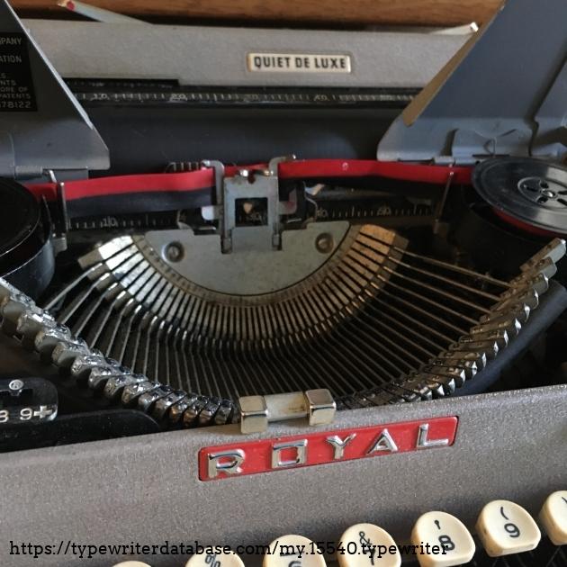 Inside of machine and Royal logo near keyboard.