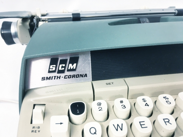 "Smith Corona ""Electra 120""  maker logo on the left side..."