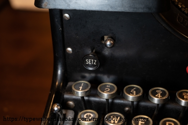 Setz = tab set button. I'm pretty sure the knob above it is for the ribbon reverse.