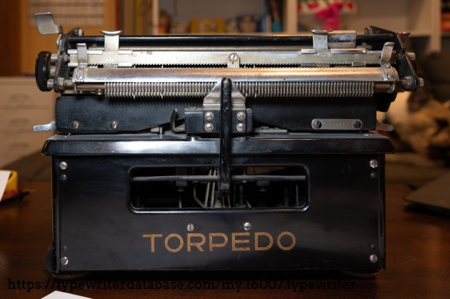 Rear view with serial number and tabulator pins visible.
