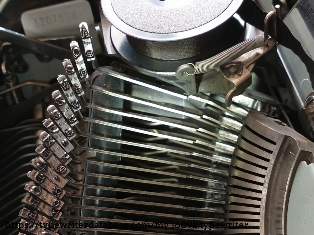 """Damage to the """"A"""" key: the metal protrusion that normally hits the solid metal part of the basket has broken off. you can also see that the indentation of the solid metal piece of the basket is more pronounced where the A key has hit it."""