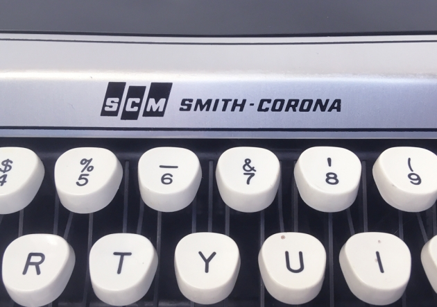 """Smith Corona """"Corsair Deluxe"""" from the maker logo on the front..."""