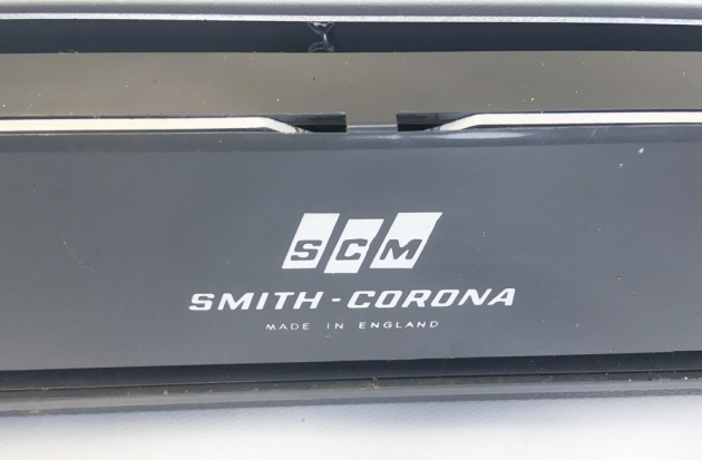 """Smith Corona """"Corsair Deluxe"""" from the maker logo and country of origin on the back... (detail)"""