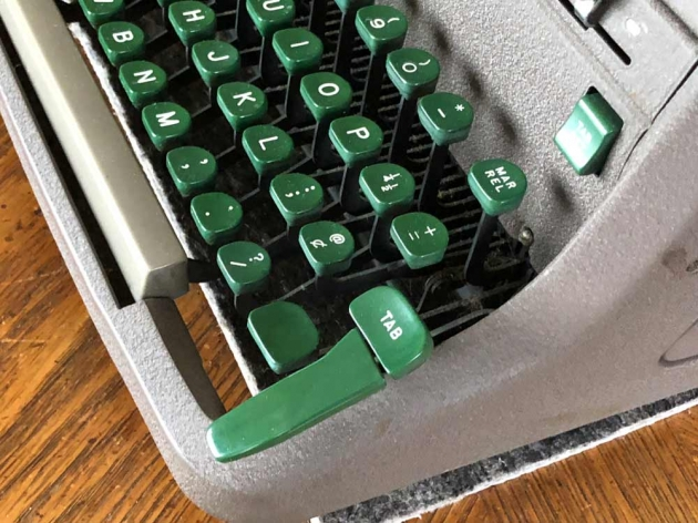 "The iconic Tab key of the Royal HH. The smaller key marked ""TAB"" can be triggered with the pinkie as usual; the giant palm tab key can be hit when you're excited or in a hurry; it then pushes the smaller key down to effect the Tab action."