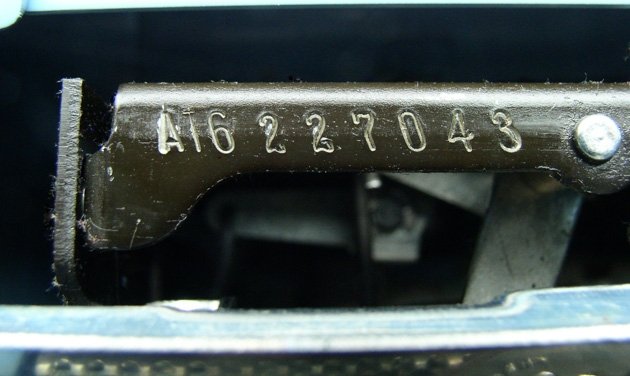Here's a pic of the serial number; good luck discerning that second character. A close-up is in the next pic. You could make a case that the first three characters are a different typestyle from the last six and thus are a separately stamped prefix, except that the 6 and the 0 look like the same style....
