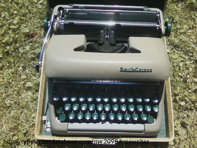 """This is the photo that my friend texted me, recently recovered from the digital abyss. The accompanying message: """"There's an auction on my street and they're selling typewriters."""""""