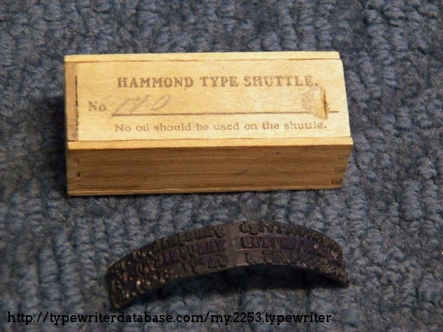 """This additional type shuttle is labeled No. 170 and contains the Clarendon font, which was introduced in 1915. """"170"""" actually is marked on the shuttle over an accent character between the 7 and 8 characters. The dovetailed wood box is about 3 inches by 1-1/4 inches."""