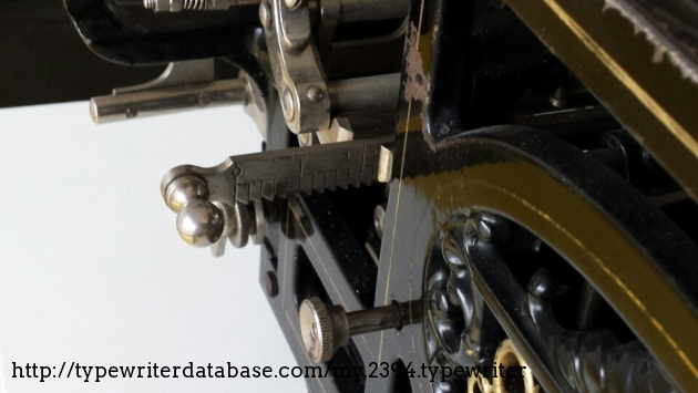 From the left side you can adjust the right margin setting by this lever.