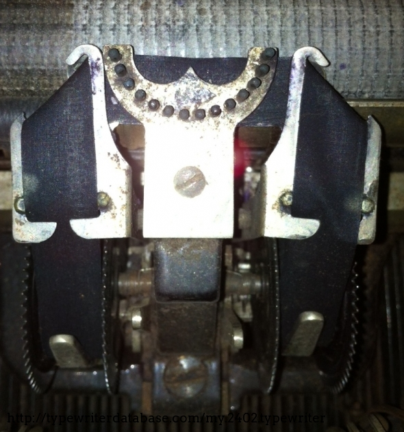That pins act as typebar-guides, and give the name (Bar-Lock) to the typewriter.