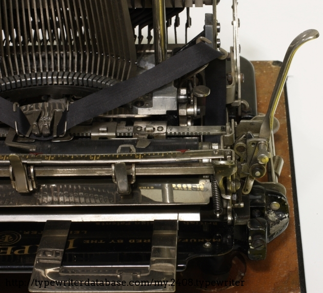 The line spacing is adjustable in two positions, the margin setting is on the front of the platen.