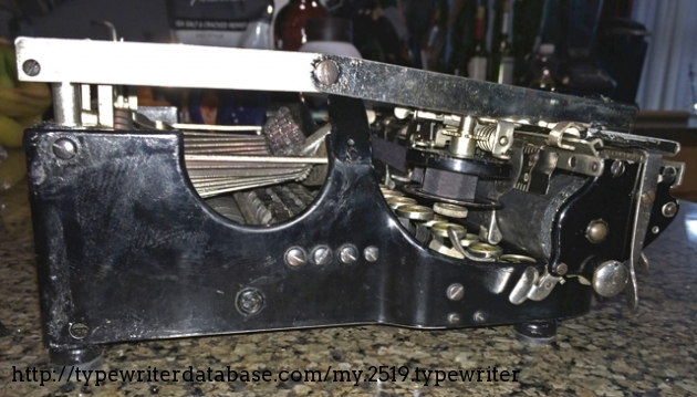 """Side view with typewriter """"folded"""" for transport."""