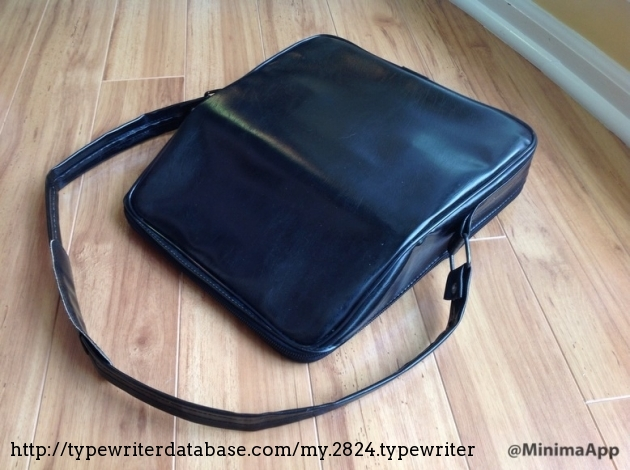 With the case shut and zipped up; sitting horizontally.