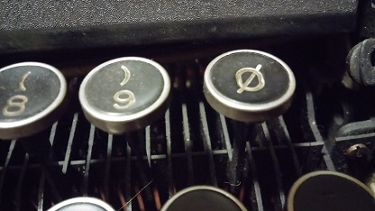 This pic shows the slashed zero key only on radio mills.