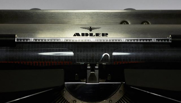 Paper table and carriage detail with Adler branding